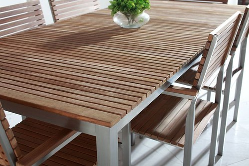 teak and stainless steel patio dining set