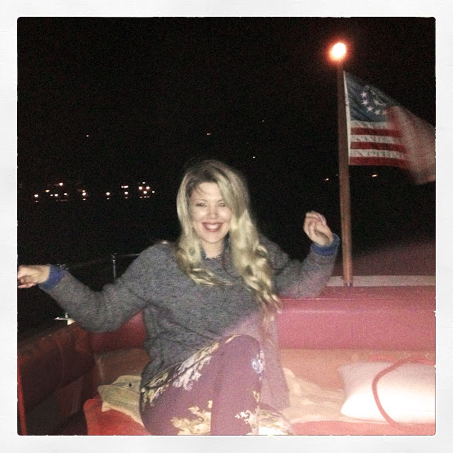 me at the back of the boat at night