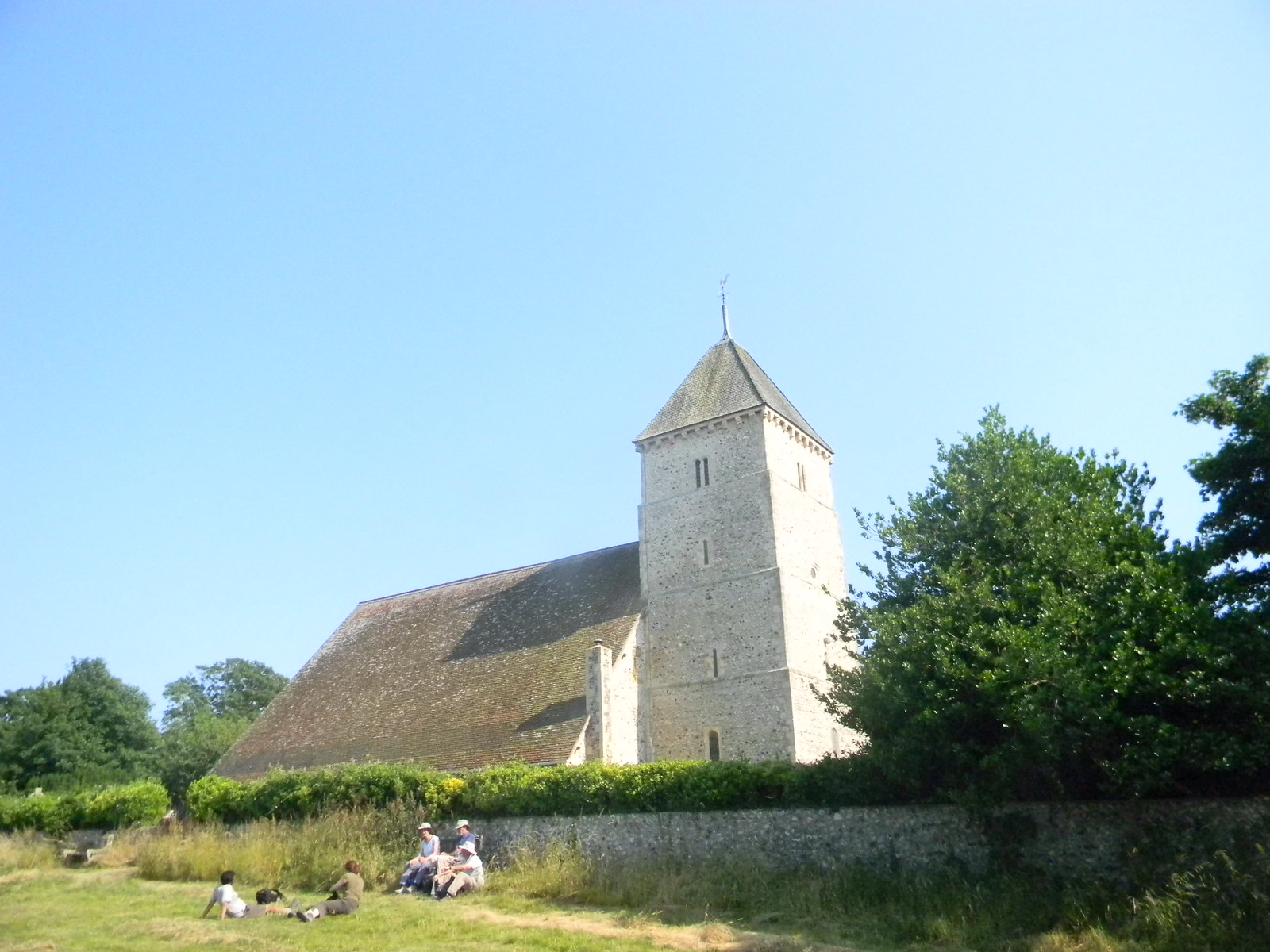 Bishopstone church. The others rest after catching up with me. Lewes to Seaford (composite route)