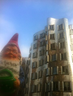 Nis the Globetrotter Garden Gnome in front of Frank O. Gehry buildings, Düsseldorf, Germany, November 2013