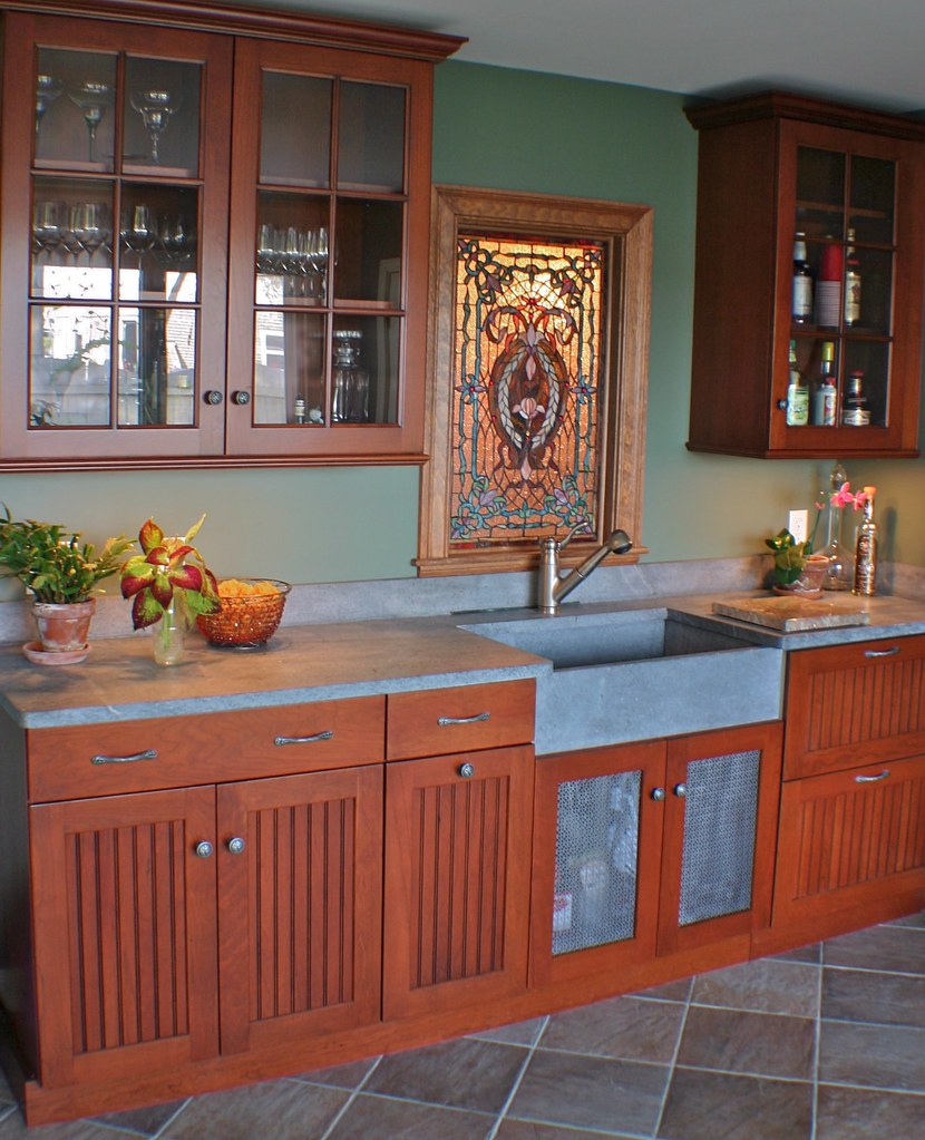 potting area by day, wet bar by night - rugged materials do double-duty.