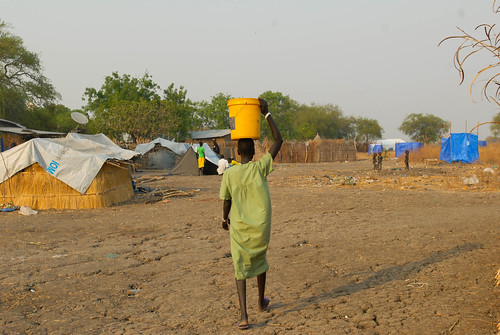 A women in Tergol town, Akobo Woreda, carries water to her home.
