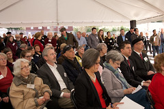 Grand Opening Attendees Listening to Speakers