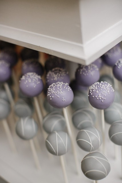 Gray pops with a white drizzle and pastel purple pops with sweet white nonpareils