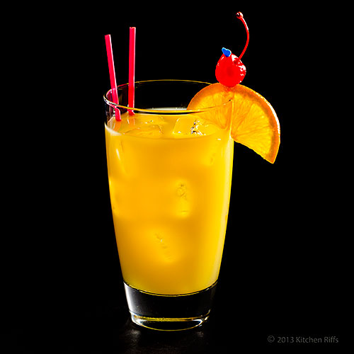 Harvey Wallbanger Cocktail with garnish of orange slice and maraschino cherry