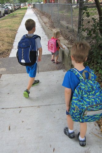 the boys, walking to THEIR school.