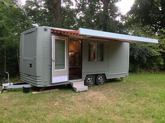 vehicle(0.0), kiosk(0.0), shed(0.0), outdoor structure(1.0), trailer(1.0), travel trailer(1.0),