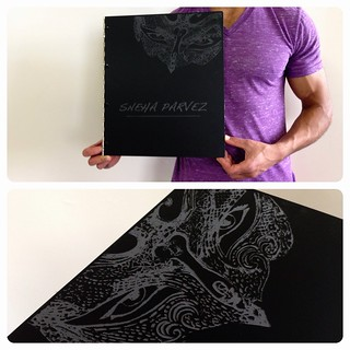 Custom matte black fashion design portfolio book with engraving treatment