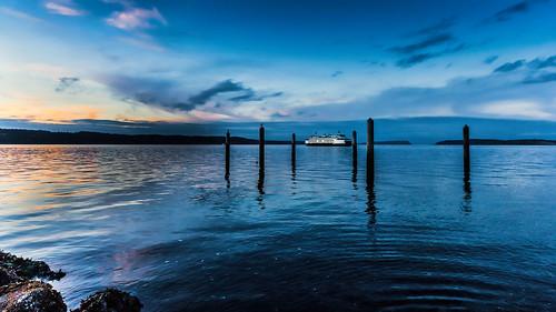 blue sunset sky orange fall water birds ferry clouds washington rocks unitedstates dusk magenta shore serene ripples posts peir mukilteo