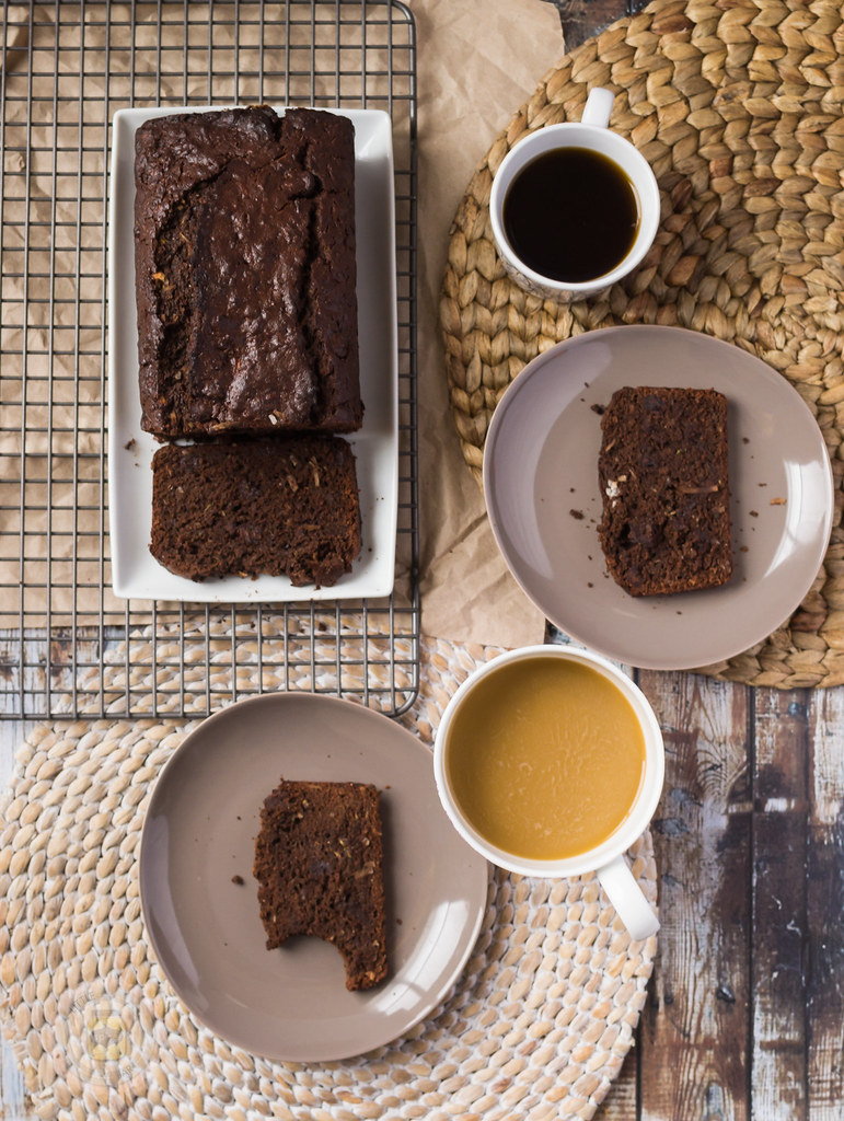 Chocolate Coconut Zucchini Bread plated with coffee cups