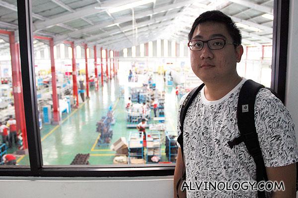 Me, standing by the window overlooking the factory floor