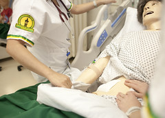 Picture of student working in simulation lab