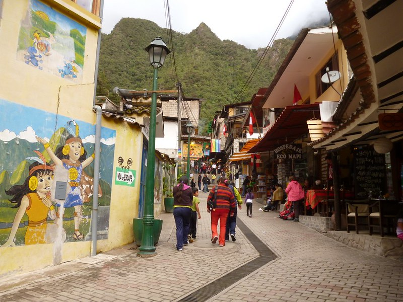 Happy kids mural and the pathway in Aguas Calientes