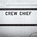 Sign of Crew Chief on side of military airplane.