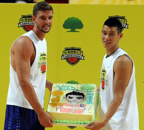 August 23rd, 2013 - Jeremy Lin and Chandler Parson hold Jeremy's 25th birthday cake at a basketball camp in Taiwan