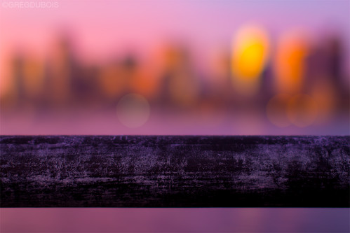 Rail with Bokeh of Boston Skyline and Harbor at Sunrise, Lo Presti Park East Boston