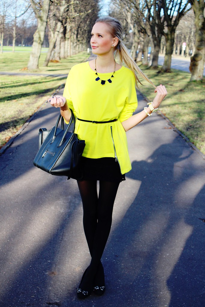 New outfit post on www.callmemaddie.com : in this outfit you can see a side zipper neon color sweater from Persunmall, skull bracelet from Persunmall, mini skirt from H&M, tote handbag celine bag look a like for  a cheaper price