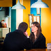 A couple in a restaurant by Paco CT