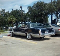 limousine(0.0), automobile(1.0), automotive exterior(1.0), cadillac(1.0), vehicle(1.0), cadillac fleetwood(1.0), cadillac brougham(1.0), full-size car(1.0), sedan(1.0), land vehicle(1.0), luxury vehicle(1.0),