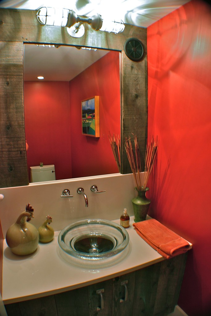 a variety of textures and colors provide visual and tactile delight in this small powder room