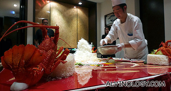 The chef preparing the yu sheng layout