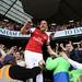 Lukas Podolski celebrates with the Arsenal fans by Stuart MacFarlane