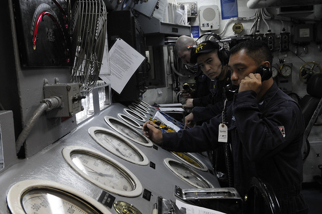 Sailors monitor the pressure gauges in the engine room aboard the USS Blue Ridge