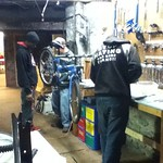 Tyler, and  Terrell in the bike shop with Mr. Vic