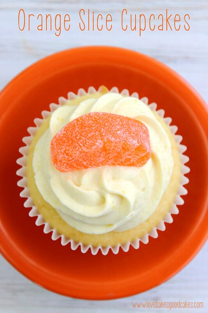 Orange Slice Cupcake in orange bowl with an orange candy on top looking from the top down.