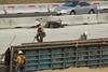 Closeup of man preparing the center barrier on Hwy 4's westbound lane, west of G Street.