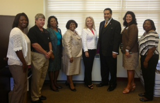 New SFSP Sponsor:  Alabama Department of Education's Danielle Turk (middle) with Tuskegee University First Lady Patricia Rochon (Left) and her husband Dr. Gilbert Rochon, President of Tuskegee University (Right), pose with Macon County's newest Summer Feeding Site representatives after becoming the County's new Summer Sponsor in June 2013.