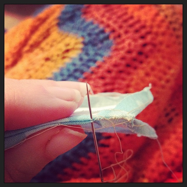 Paper piecing under a cozy crocheted blanket. #yearofmaking 6/375