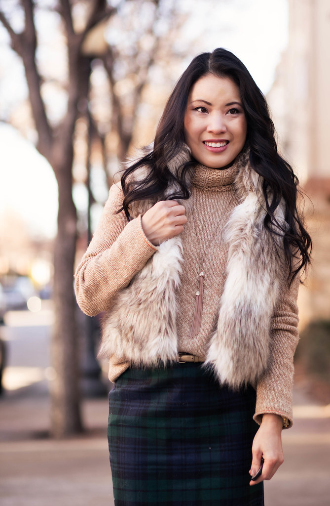 cute & little blog | fur vest, chunky turtleneck, plaid pencil skirt, brown tights, nude pumps, tassel necklace outfit