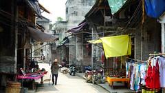 shopping(0.0), tourism(0.0), urban area(0.0), slum(0.0), town(1.0), market(1.0), road(1.0), bazaar(1.0), alley(1.0), public space(1.0), street(1.0), neighbourhood(1.0), infrastructure(1.0), travel(1.0),