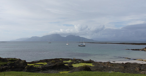 Raasay, anchored in Gallanach bay, Muck. Rum in the background.