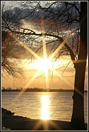 sunset sun sunburst trees silhouettes lake lakeside water waterscape waterscene nature clouds bright light foxlake wisconsin canon canoneos60d picmonkey:app=editor reflection merleearbeen meaimages