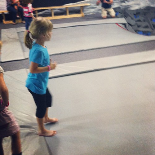 My super cautious girl getting ready to jump off a trampoline into a pit of foam blocks.