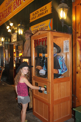 Vali with a fortune teller machine at Wall Drug
