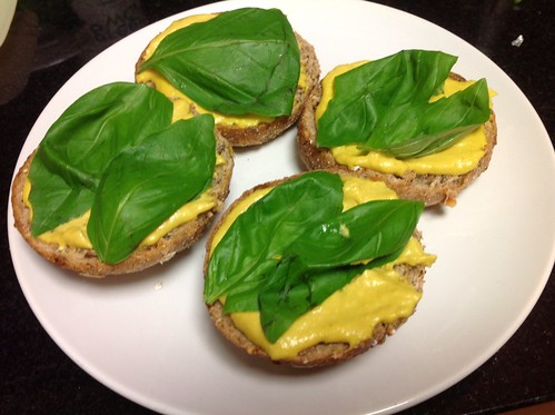 Cashew spread on rolls with basil leaves