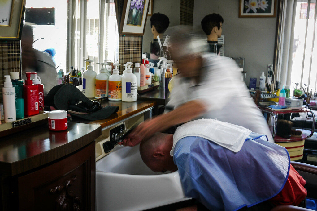 Getting a haricut the oldschool way by an 81 year old barber in Haboro Town, Hokkaido, Japan