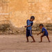 Kids playing in the streets of Massawa, Eritrea by Benoit Cappronnier