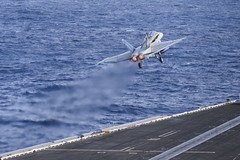 """An F/A-18C Hornet assigned to the """"Blue Diamonds"""" of Strike         Fighter Squadron (VFA) 146 launches from the aircraft carrier USS         Nimitz (CVN 68) during the departure of Carrier Air Wing (CVW) 11.         CVW-11 fixed wing aircraft flew off Nimitz to return home after more         than eight months deployed to the U.S. 5th, 6th and 7th Fleet areas         of responsibility. (U.S. Navy photo by Mass Communication Specialist         3rd Class Derek A. Harkins)"""