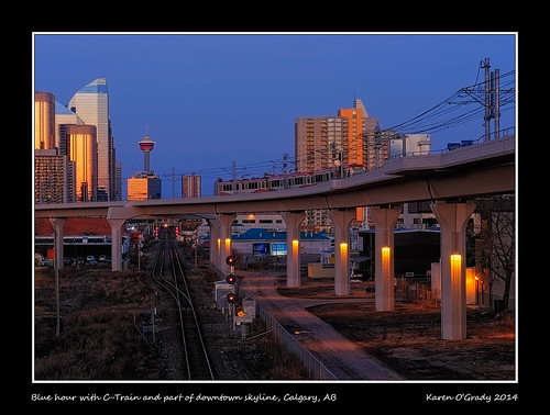 Blue hour with C-Train and part of downtown skyline, Calgary, Alberta