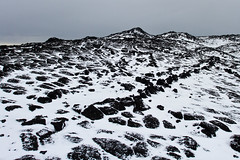 21561-Lava-rocks-&-snow-at-Cape-Royds