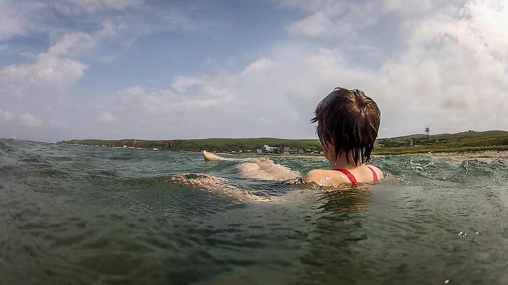 Swimming in the cool clear waters of Funadomari Bay, Rebun Island, Hokkaido, Japan