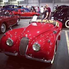 automobile, jaguar xk120, vehicle, automotive design, auto show, antique car, classic car, vintage car, land vehicle, luxury vehicle, convertible, supercar, sports car,