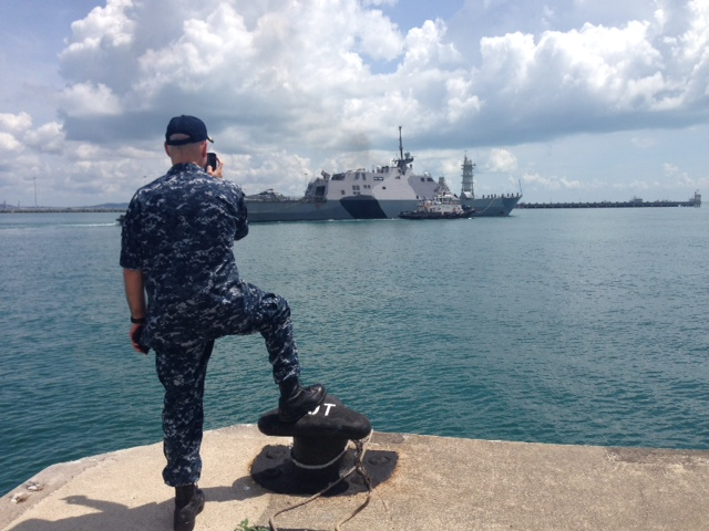 Captain Paul Schlise, Commodore DESRON 7, bids farewell to USS FREEDOM (LCS 1) as she departs Changi Naval Base, Singapore.