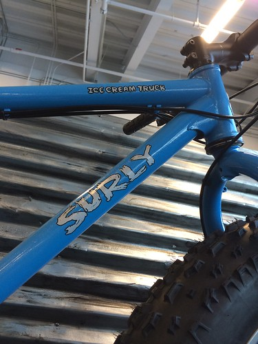 Cropped, right side view of the upper, front portion of  blue Surly Ice Cream Truck fat bike