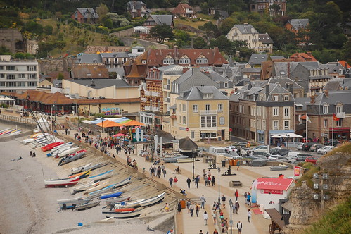 Busy Etretat, France, with boats and tourists