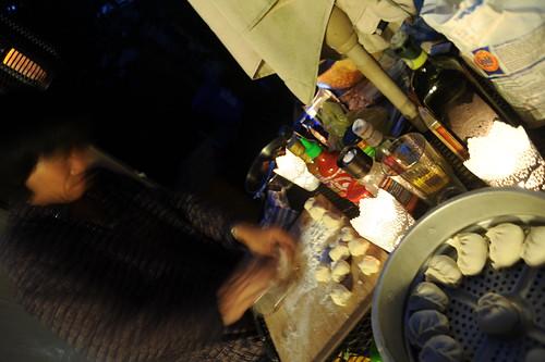 Carson making Tibetan Mo-Mo's on the back porch, steam basket, luminaries, ingredients, flour, salt, oil, hot sauce, Himalayan salt, Seattle, Washington, USA by Wonderlane